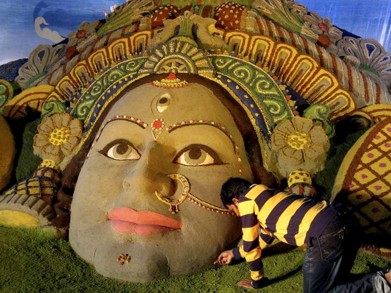 Sand artist Sudarshan Pattnaik creates a sculpture of Goddess Durga for Durga Puja festival in Siliguri.