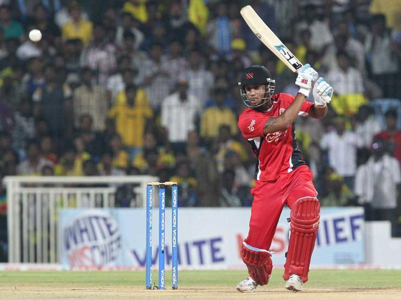 Trinidad and Tobago batsman Lendl Simmons plays a shot during the Champions League T20 Cricket match at MA Chidambaram Stadium in Chennai.