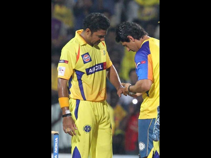 Chennai Super Kings bowler Shadab Jakati is treated for an injury to his finger, during the CLT20 match against Trinidad and Tobago at MA Chidambaram Stadium in Chennai.