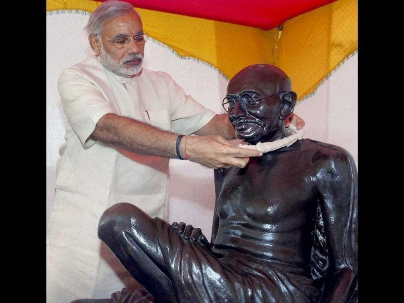 Gujarat chief minister Narendra Modi puts a garland on Mahatma Gandhi's statue, on the occasion of Mahatma Gandhi's birth anniversary in Ahmedabad.