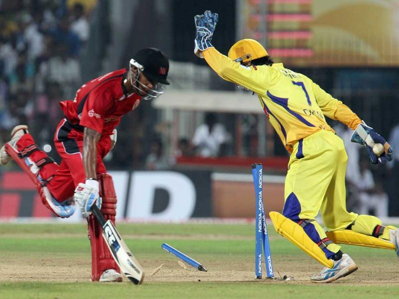 Trinidad and Tobago Lendl Simmons is run out by Chennai Super Kings MS Dhoni during the CLT20 match at the MA Chidambaram Stadium in Chennai.