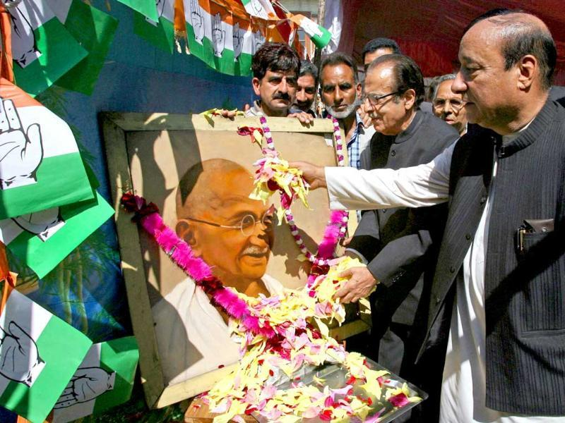 State Congress president Saif-ud-Din Soz with other senior leader paying floral tribute to Mahatma Gandhi, during the Gandhi Jayanti celebration in Srinagar.