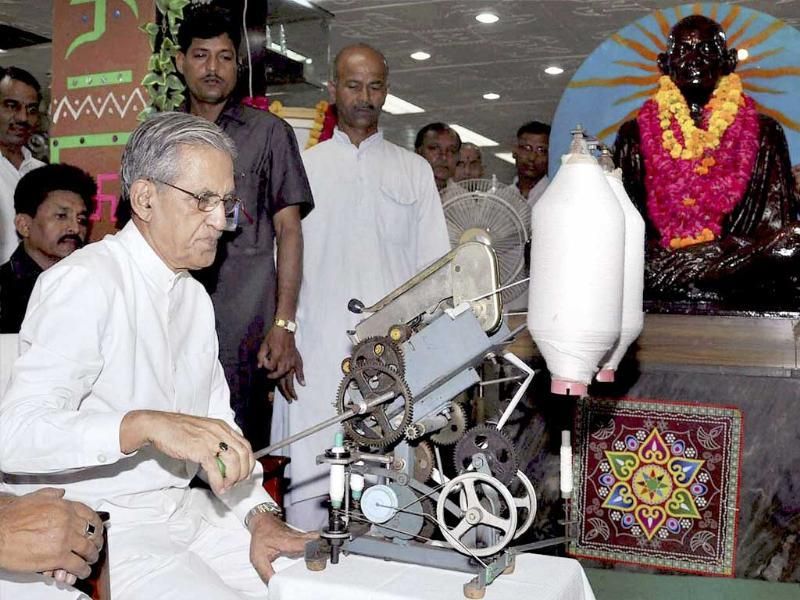 Uttar Pradesh governor BL Joshi spins cotton on a charkha on the occasion of Mahatma Gandhi Jayanti at Gandhi Ashram in Lucknow.