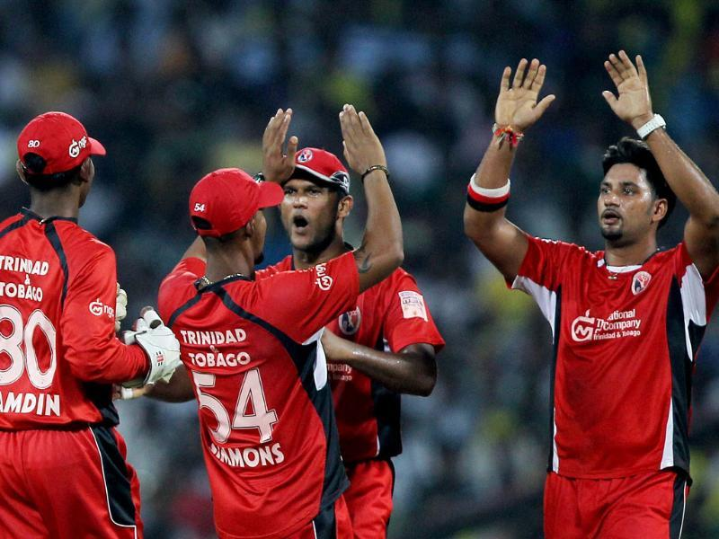 Ravi Rampaul of Trinidad and Tobago along with teammates celebrating a wicket of Chennai Super Kings' M Hussey during the Champions league T20-2011 match in Chennai.
