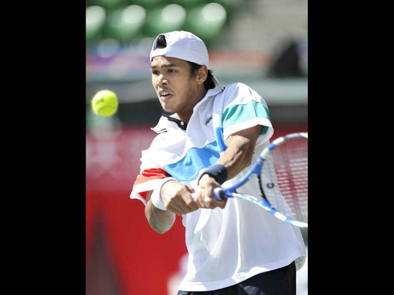 Somdev Devvarman hits a return against Radek Stepanek of the Czech Republic during their first round match at the Japan Open tennis tournament in Tokyo.