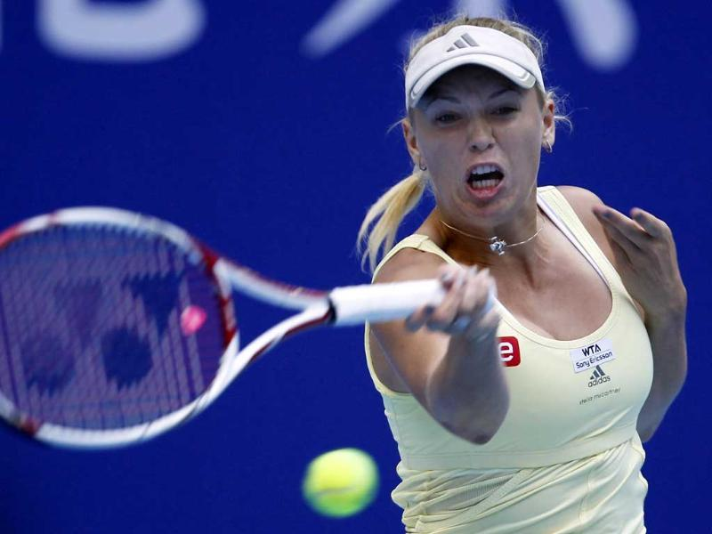 Denmark's Caroline Wozniacki returns the ball from the Czech Republic's Lucie Hradecka during the women's singles tennis match of the China Open tennis competitions held in Beijing.