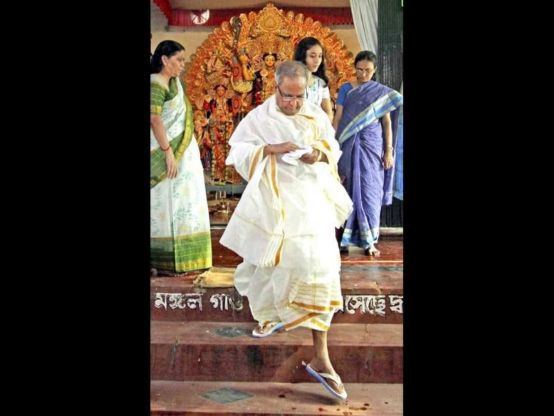 Union finance minister Pranab Mukherjee prepares to perform the worship of Goddess Durga at his ancestral home in Mirati village in Birbhum district of West Bengal.