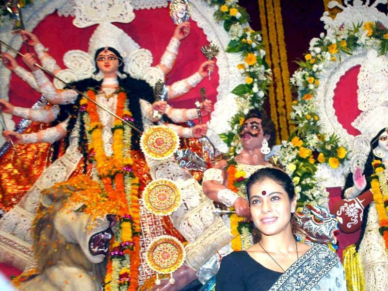 Bollywood actress Kajol visits the North Bombay Durga Puja Mandal during the Navratri Festival, in Mumbai.