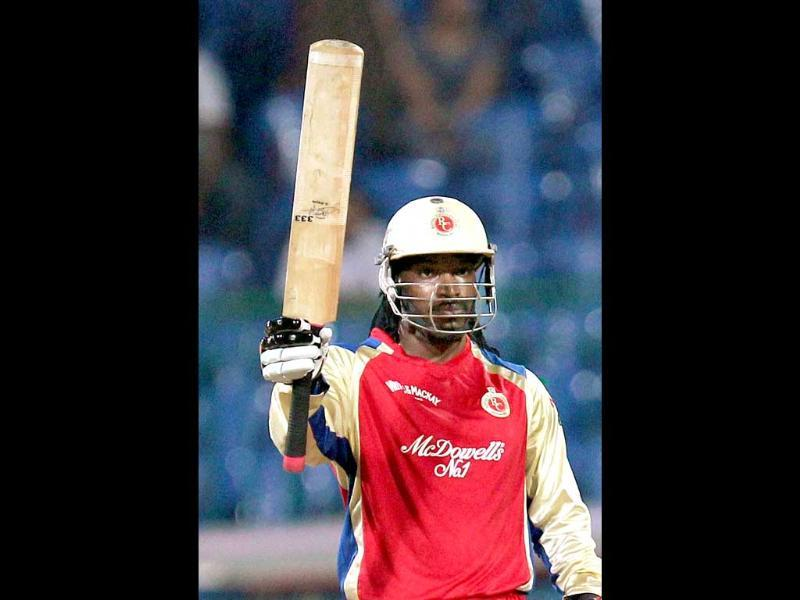 Royal Challengers Bangalore batsman Chris Gayle celebrates his half century against Somerset during the Champions League T20-2011 match in Bangalore.