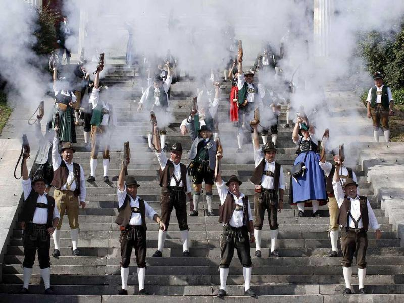 Around 60 shooters in traditional Bavarian clothes fire off salutes during a last day ceremony at Munich's Oktoberfest.