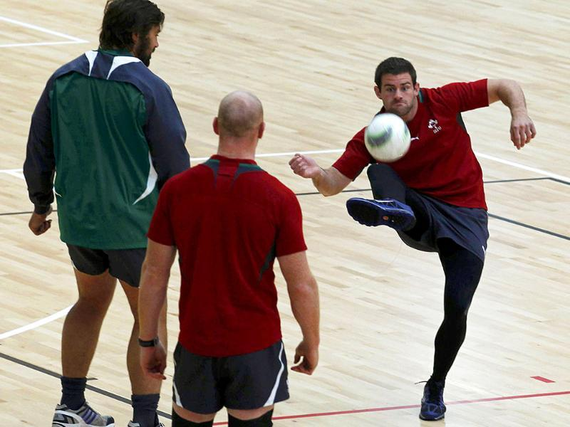 Ireland's Fergus McFadden kicks a soccer ball next to teammates Tony Buckley and Paul O'Connell during a training session in Wellington. Ireland will play against Wales in their Rugby World Cup quarter-final match.