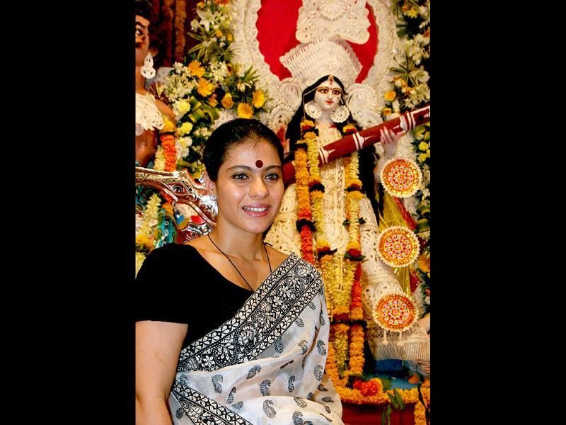 Kajol looks a true-blue Bengali in front of the Durga idol.