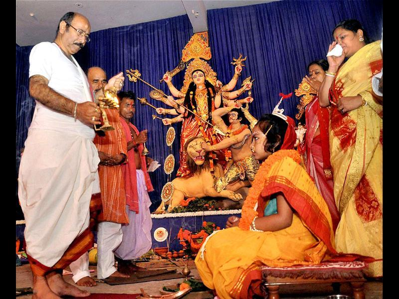 Priests perform 'Kunwari Kanya' puja on the auspicious Maha Ashtami of Durga Puja at a pandal in Ranchi.
