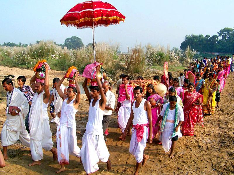 Priests along with devotees perform during Durga Puja festival in Bankura district in West Bengal.
