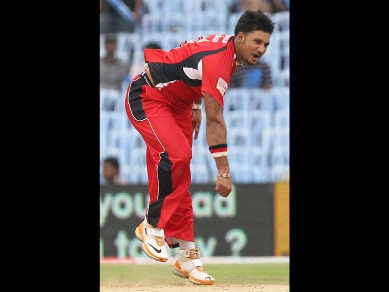 Trinidad and Tobago's Ravi Rampaul bowls during their Champions League Trophy T20 Cricket match against Cape Cobras at MA Chidambaram Stadium in Chennai.