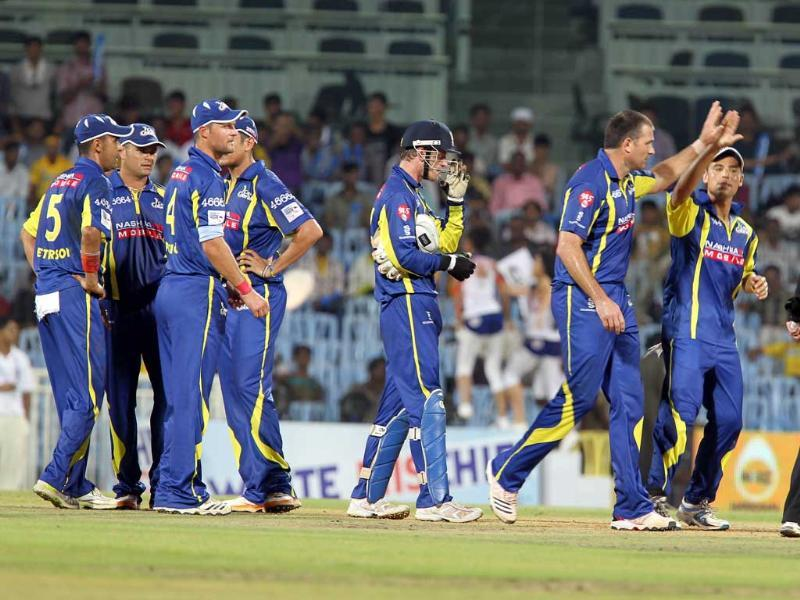 Cape Cobras team celebrate the dismissal of Daren Ganga of Trinidad and Tobago by Justin Kemp during their Champions League Trophy T20 cricket match at MA Chidambaram Stadium in Chennai.