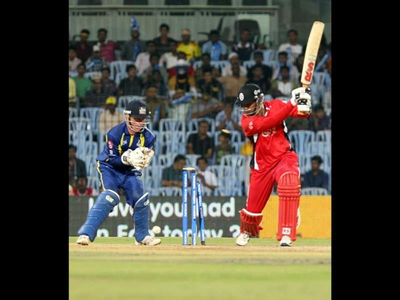 Team captain of Trinidad and Tobago Daren Ganga is bowled out by captain of Cape Cobras Justing Kemp during their Champions League Trophy T20 cricket match at MA Chidambaram Stadium in Chennai.