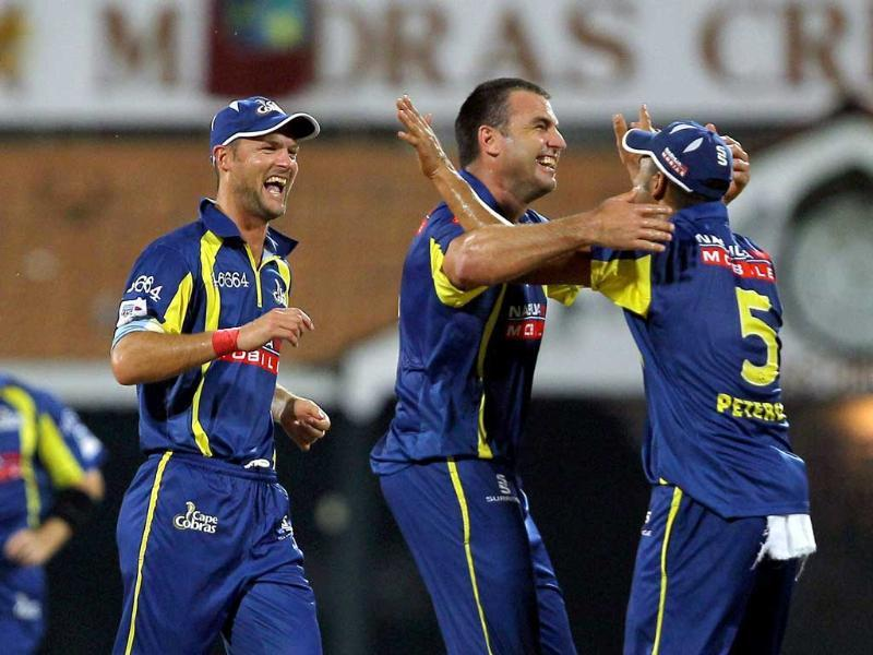 Cape Cobras' skipper Justin Kemp along with teammates celebrating the wicket of Trinidad and Tobago's Skipper Daren Ganga during the Champions league T20-2011 match in Chennai.