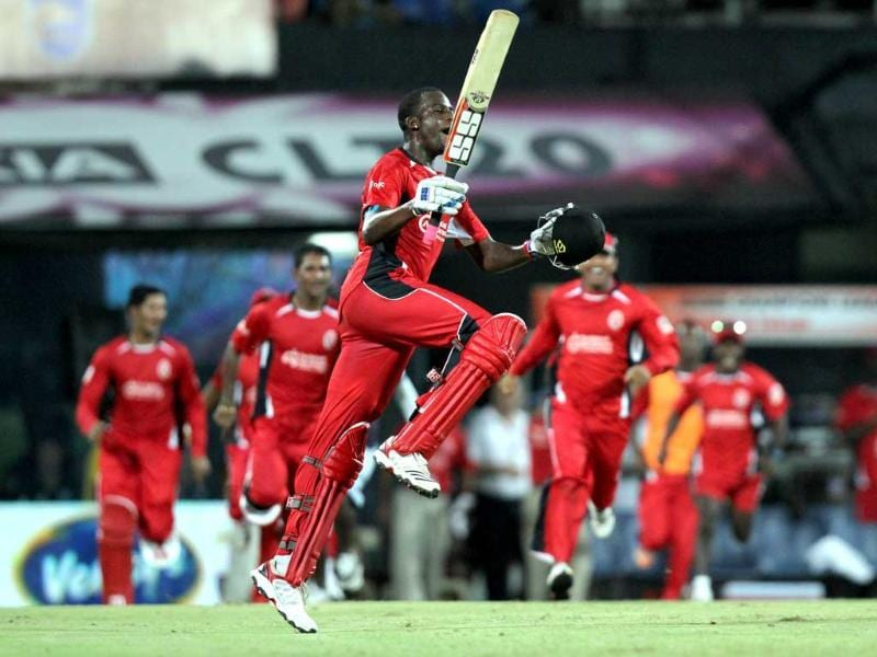 Trinidad and Tobago batsman Kevon Cooper and team mates celebrate after won the match against Cape Cobras during the champions league at MA Chidambaram Stadium in Chennai.