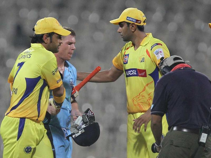 New South Wales Blues' David Warner being congratulated by Chennai Super Kings skipper MS Dhoni and his teammates during their Champions League T20-2011 match in Chennai.