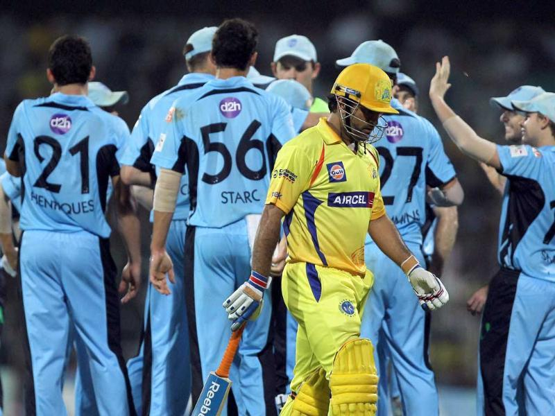 Chennai Super Kings' skipper MS Dhoni returns to pavilion after losing his wicket during the Champions League T20-2011 match against New South Wales Blues in Chennai.