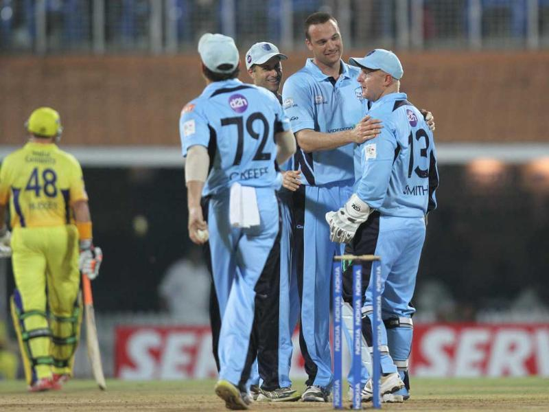 New South Wales Blues celeberate after the dismissal of Chennai Super Kings batsman Michael Hussey during the CLT20 match between New South Wales Blues at Chidambaram Stadium in Chennai.