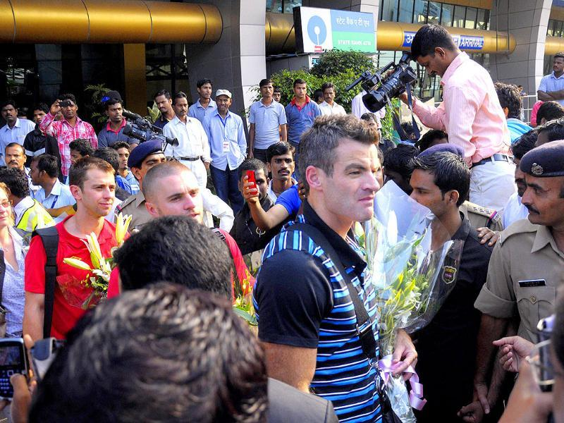 Blackburn Rovers FC captain Ryan Nelsen (R) arrives with teammates at the airport in Pune.