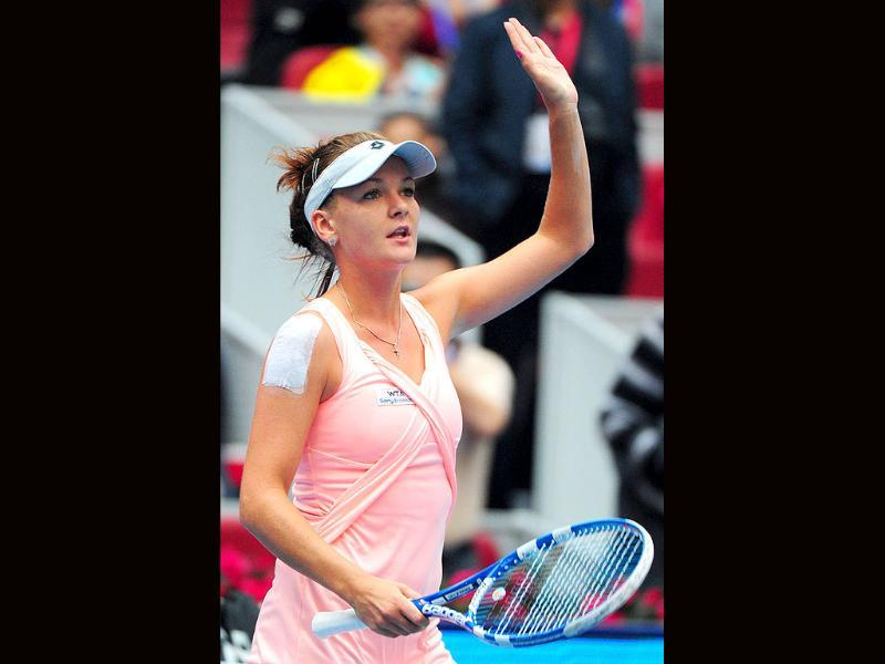 Agnieszka Radwanska of Poland celebrates after defeating Zheng Jie of China in their second round match at the China Open tennis tournament in Beijing. Radwanska won 6-1, 6-4.