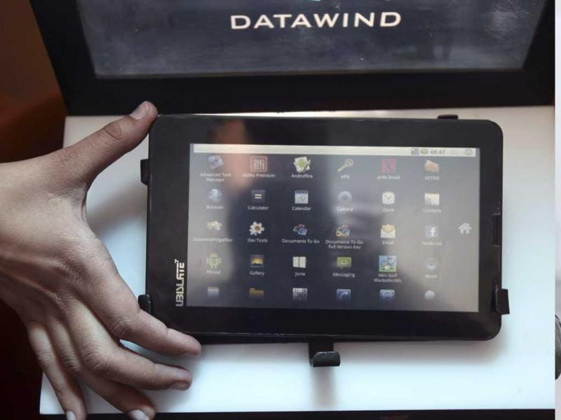 A DataWind representative displays the supercheap Aakash Tablet computers during its launch in New Delhi.