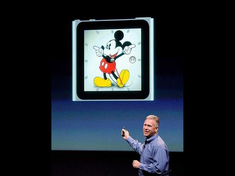 Apple's senior VP of Worldwide product marketing Phil Schiller speaks about the new clock face for the iPod Nano during introduction of the new iPhone 4s.