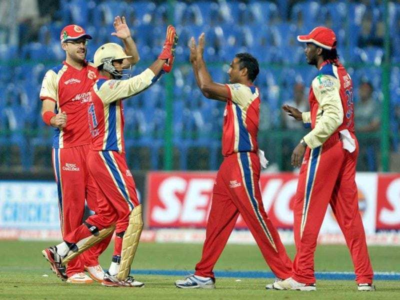 Wicketkeeper of Royal Challengers Bangalore Arun Karthik (2L) celebrates with his teammates after stumping out batsman Michael Klinger of South Australia during the Champions League Twenty20 League cricket match between Royal Challengers Bangalore (RCB) and South Austrailian Redbacks (SAR) at the M Chinnaswamy Stadium in Bangalore.