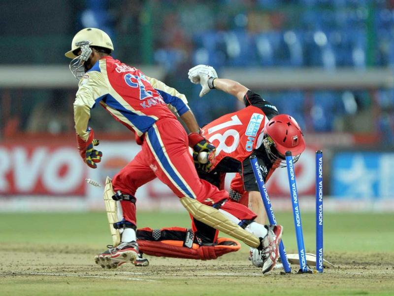 Batsman Michael Linger of South Australia makes a futile attempt to get back into the crease as wicket keeper of Royal Challengers Bangalore Arun Karthik stumps him out during the Champions League Twenty20 League cricket match between Royal Challengers Bangalore (RCB) and South Austrailian Redbacks (SAR) at the M Chinnaswamy Stadium in Bangalore.