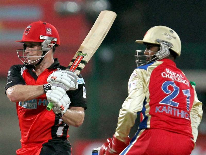 South Australian Redbacks Daniel Harris plays a shot against Royal challengers Bangalore during the Champions League T20-2011 match in Bangalore.