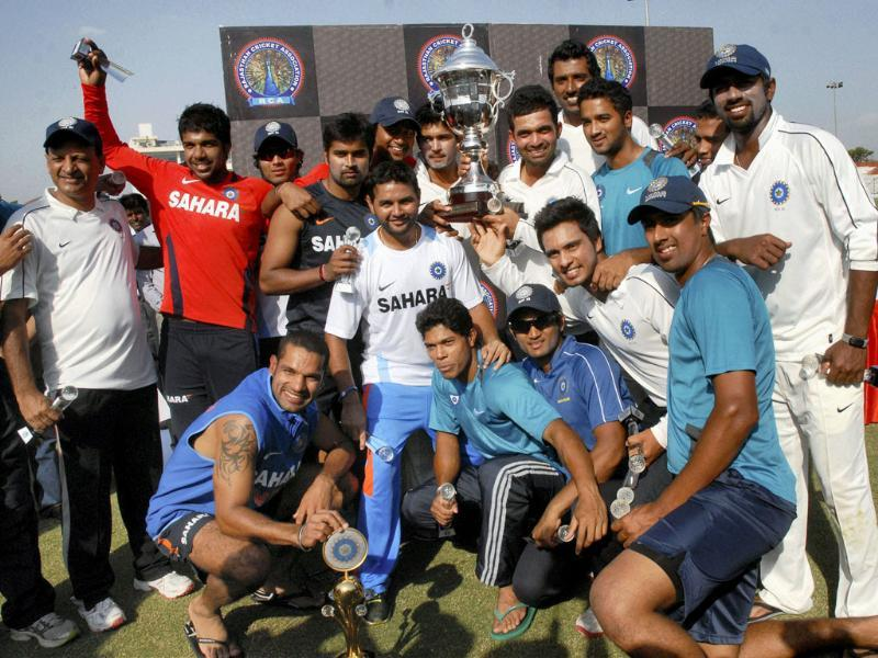 Rest of India team with Irani Cup pose for photographers at SMS Stadium in Jaipur on Wednesday.