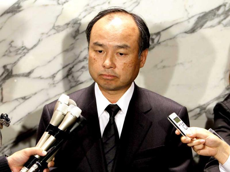 Softbank Mobile's chief executive officer Masayoshi Son speaks to the media regarding the obituary of Apple's founder Steve Jobs at Son's company in Tokyo.