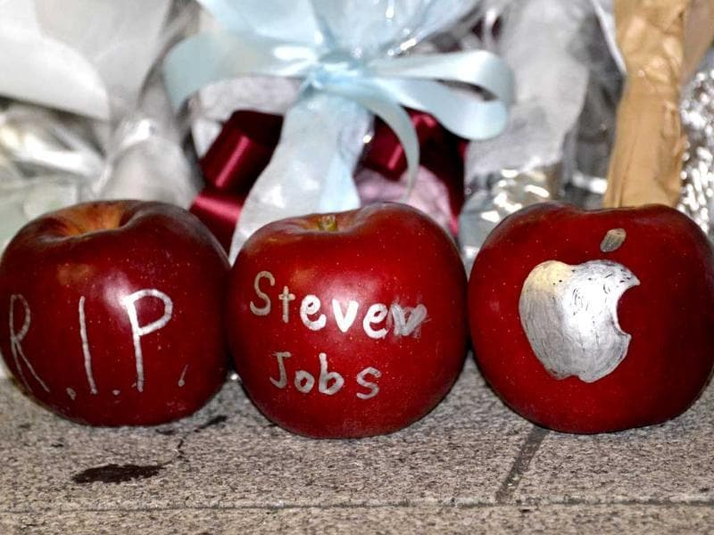 Apples with messages paying tribute to Apple co-founder Steve Jobs outside an Apple store in Tokyo.