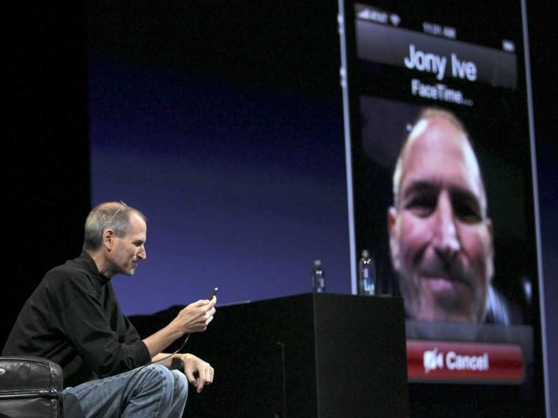 Apple CEO Steve Jobs demonstrates video conferencing with Apple Senior Vice President for Industrial Design Jonathan Ive at the unveiling of the iPhone 4 in San Francisco, California in this June 7, 2010, file photo.