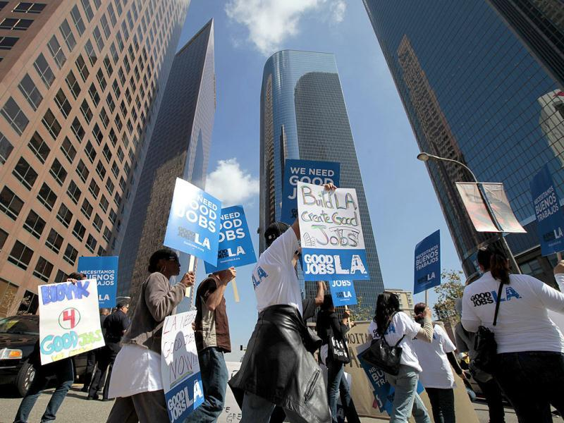 Protesters march through the financial district during a