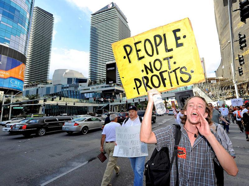 A protester affiliated with the Occupy Las Vegas movement, takes part in a march on the Las Vegas Strip in Las Vegas, Nevada.