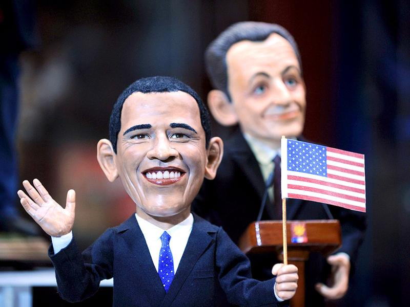 Dolls depicting US President Barack Obama (L) and his French counterpart Nicolas Sarkozy by designer Igor Viguzov are displayed during