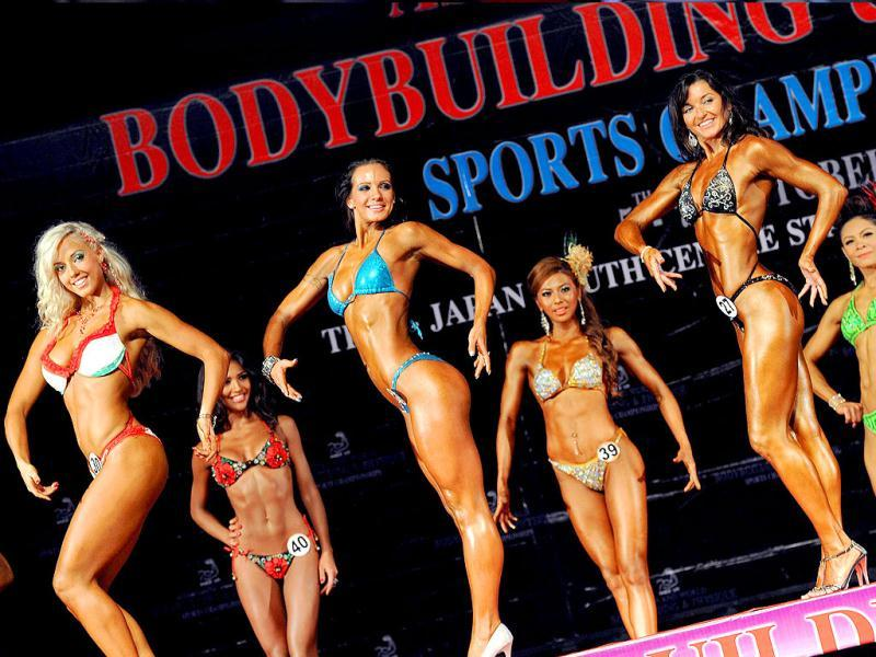 Contestants compete in the first round of the world women model physique over 165 cm. category at the Asian and World Bodybuilding and Physique Sport Championships in Bangkok.
