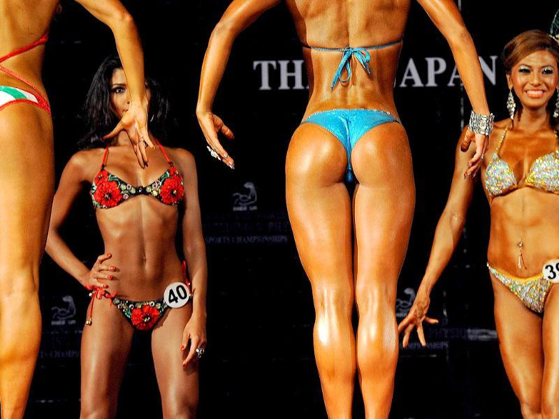 Contestants compete in the first round of the world women model physique over 165cm. category at the Asian and World Bodybuilding and Physique Sport Championships in Bangkok.
