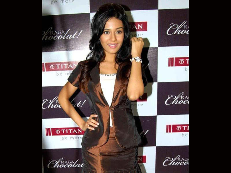 Amrita Rao dons a white Titan Raga watch with her chocolate brown three-piece dress.