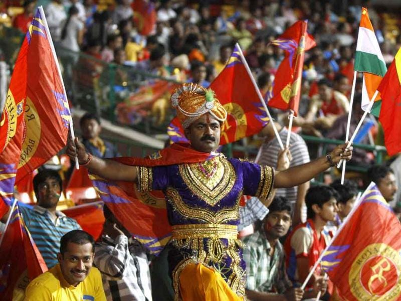 A Royal Challengers Bangalore supporter sports traditional attire as he cheers for his team before the start of the Champions League Twenty20 cricket semifinal match between Royal Challengers Bangalore and New South Wales in Bangalore.