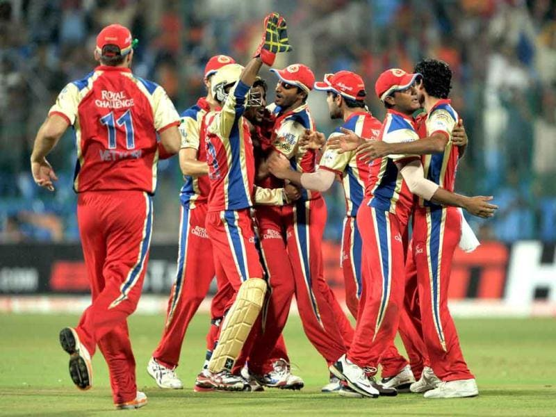 Royal Challengers Bangalore players celebrate the dismissal of Shane Watson during the Champions League Twenty20 first semi final match.