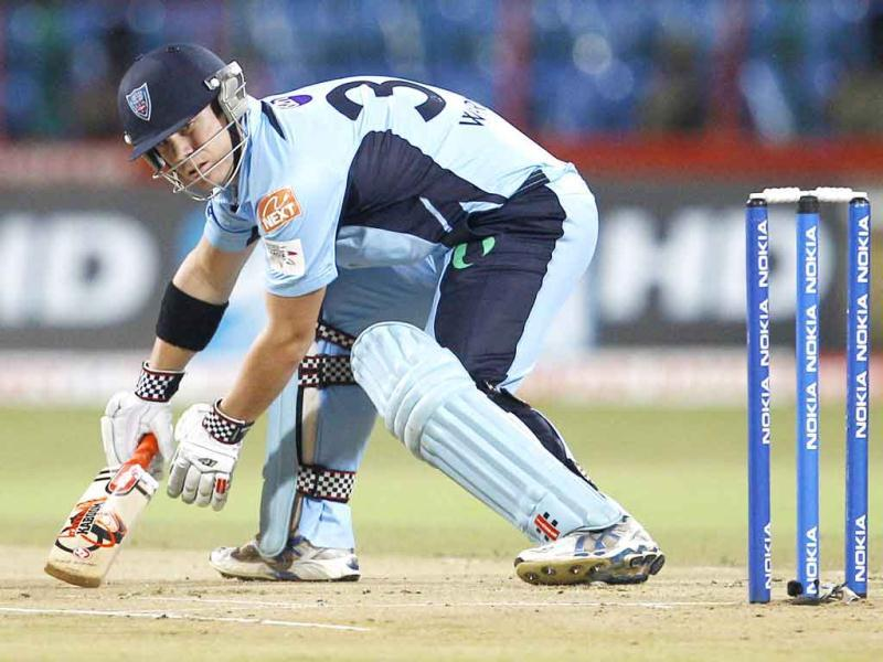 New South Wales' batsman David Warner watches his shot during the Champions League Twenty20 cricket semifinal match against Royal Challengers Bangalore in Bangalore.