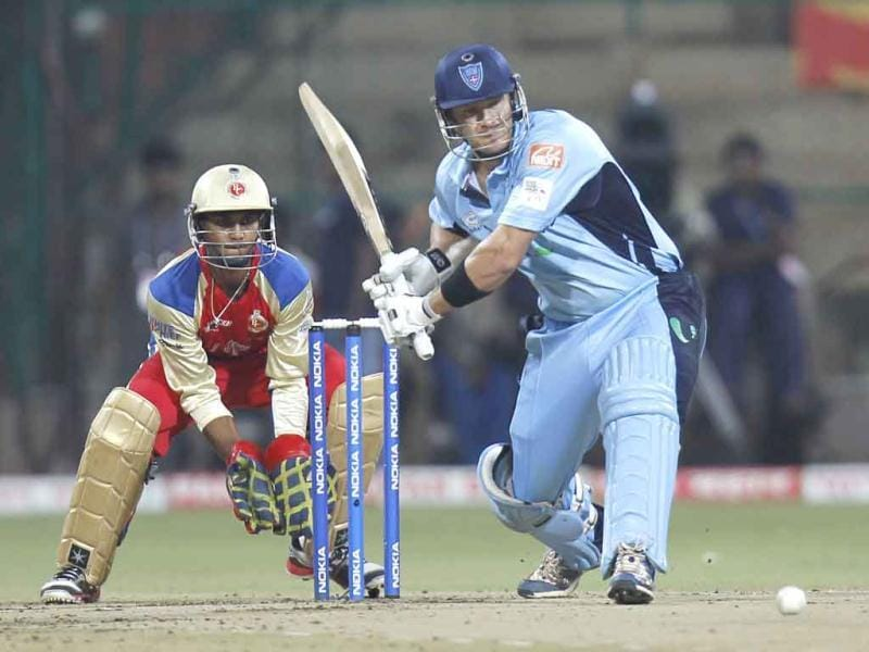 Shane Watson plays a shot during the 1st Semi Final Champions League Twenty 20 match at M. Chinnaswamy Stadium.