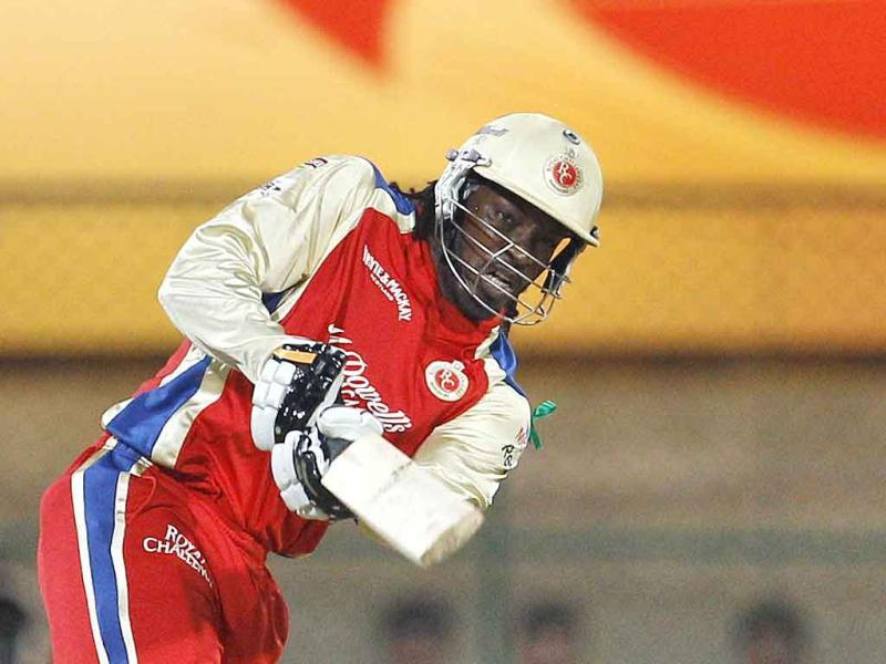 Royal Challengers Bangalore batsman Chris Gayle plays a shot during the Champions League Twenty20 cricket semifinal match against New South Wales in Bangalore.
