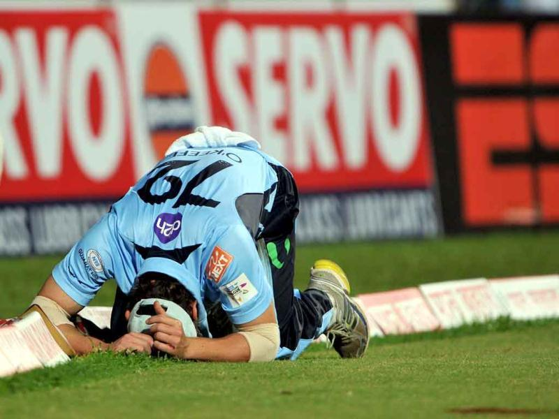 NCW Blues fielder repents a missed field that led to four runs for RCB during the Champions League Twenty20 first semi final match in Bangalore.