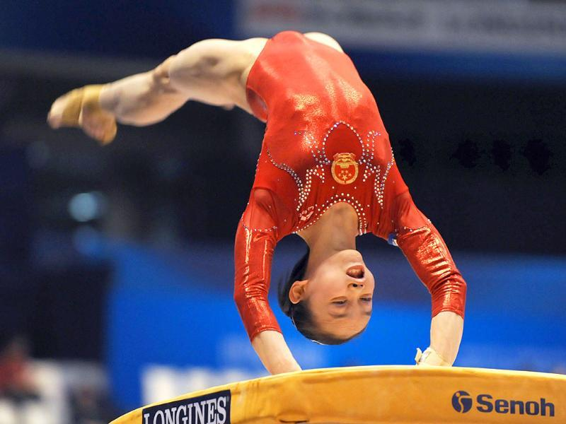 Tan Sixin of China performs on the vault during women's qualification at the world gymnastics championships in Tokyo.